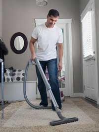 Picture of person vacuuming
