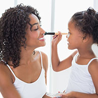 Mother and daughter putting on makeup, click to read more