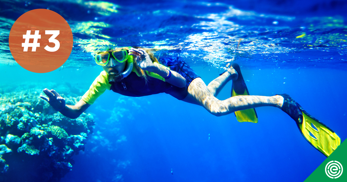 photo of a scuba diver among reefs
